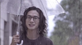 Waits for her with umbrella
